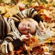 Woman portret in autumn leaf — Stock Photo #12314781
