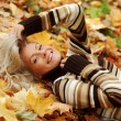 Woman portret in autumn leaf — Stock Photo #12314785
