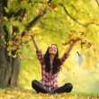 Woman drop leaves in autumn park — Stock Photo #12314830