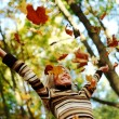 woman drop leaves in autumn park — 图库照片 #12314843