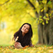 Woman portret in autumn leaf — Stock Photo #12314987
