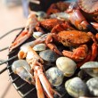 Crabs shrimps on charcoal grill — Stock Photo #12361657