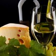 Royalty-Free Stock Photo: White wine and cheese on black