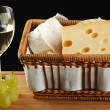 Royalty-Free Stock Photo: White wine in fine glass with cheese and grape