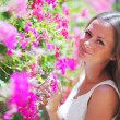 Woman in flowers — Stock Photo #12521228