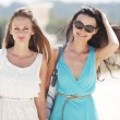 Two women over street background — Stock Photo #12521258