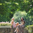 Two women over park background — Stock Photo #12521266