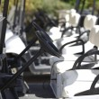 A number of the golf carts at the golf course — Stock Photo