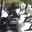 A number of the golf carts at the golf course - Stock Photo