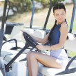 Royalty-Free Stock Photo: Woman in golf car