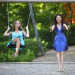 Stock Photo: Young women swinging