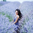 Woman sitting on a lavender field — Stock Photo