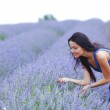Woman standing on a lavender field — Stock Photo #12521460
