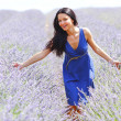 Woman standing on a lavender field — Stock Photo #12521461