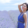 Woman standing on a lavender field — Stock Photo #12521463