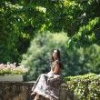 Woman in summer park - Stockfoto