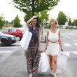 Two woman after shopping — Stock Photo #12521572