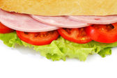Closeup of sandwich with ham and fresh vegetables — Stock Photo