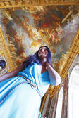 Beautiful woman in a palace interior — Stock Photo