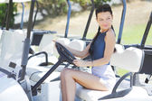 Woman in golf car — Stock Photo