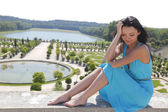 Woman in Versailles gardens France — Stock Photo