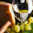 White wine and cheese on black - Stockfoto