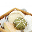 Cheese in basket close up - Stockfoto