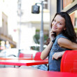 Woman in street cafe — Stock Photo #12879857