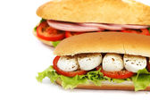 Sandwich with mozzarella tomato and salad — Stock Photo