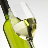 Bottle with white wine and glass — Stock Photo