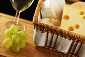 White wine in fine glass with cheese and grape — Stock Photo