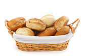 Bread in wicker basket isolated on white — Stock Photo