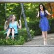Young women swinging — Stock Photo #13730270