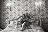 Beautiful woman on a sofa — Stock Photo