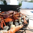 Crabs shrimps on charcoal grill - Stock Photo