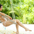 Womain in beach hammock - Stock Photo
