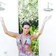 Woman in tropical shower — Stock Photo #14963105