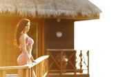 Woman near tropical hotel — Stock Photo