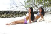 Two women relaxing on beach — Stock Photo