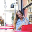 Woman in street cafe — Stock Photo