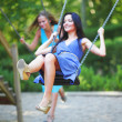Young women swinging — Stock Photo