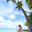 Womain in beach hammock — Stock Photo #15849191