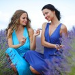 Two women on lavender field — Stock Photo #15849565