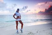Woman in sportswear on beach — Stock Photo