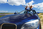 Women dance in car — Stock Photo