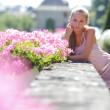 Woman in flowers — Stock Photo