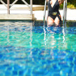 Woman in swimming pool — Stok fotoğraf