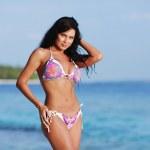 Woman in bikini on beach — Stock Photo