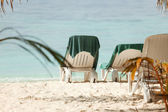 Empty chaise lounge on beach — Stock Photo