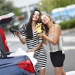 Two woman after shopping — Stock Photo